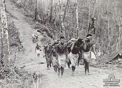 1945 06 27 Natives bringing wounded Pte J. P. Sporn in at Wearnes Hill